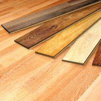 Laminate flooring color options displayed against current flooring