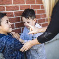 Teacher reprimands boy for bullying his classmate