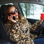 Lady drinking coffee:on phone