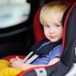 Blonde boy in car seat