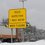 A truck Inspection sign