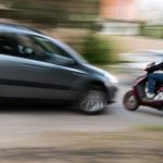 Speeding car accident about to happen with blurred speeding car and motorcycle