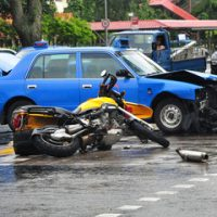 car and motorcyle in crash