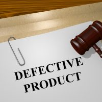 gavel on top of defective product file on top of manila envelope