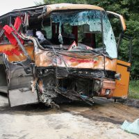 crushed bus in aftermath of a massive accident