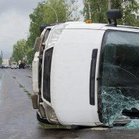 van flipped over on side after crash