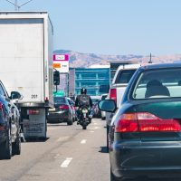 August 1, 2019 San Jose / CA / USA - Heavy traffic on one of the freeways crossing Silicon Valley; motorcyclist splitting lanes visible among cars