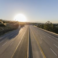 Empty ten lane route 118 freeway at sunrise in the San Fernando Valley area of Los Angeles, California.