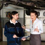 Car mechanic with angry female customer